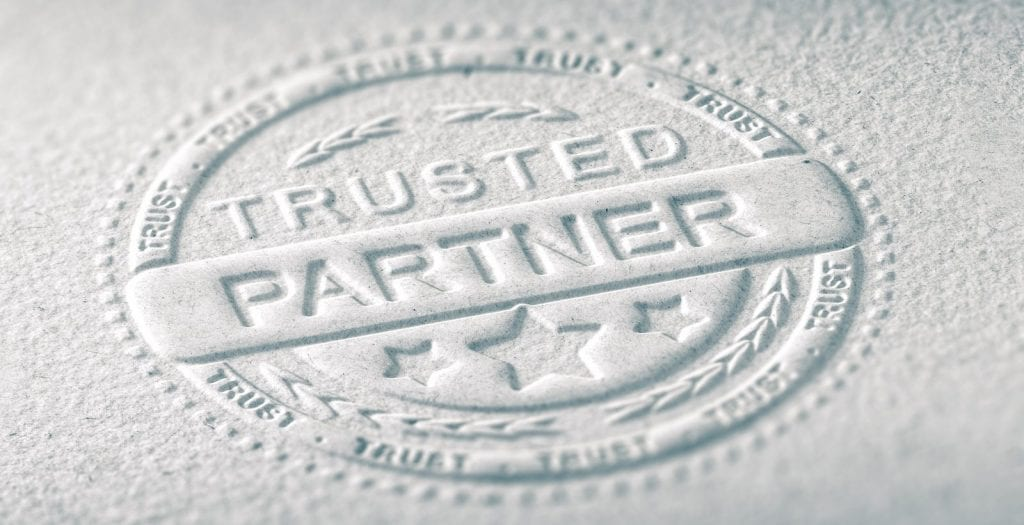 3D illustration of an embossed stamp with the text trusted partner